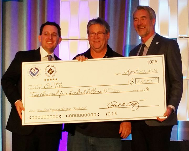Cox Tile of San Antonio, Texas: Five-Star Grand Prize for Residential Tile Installation. Pictured are (from left): Jeremy Sax, Daltile, John Cox and Jim Olson.