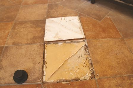 Tile was detached due to waterproof membrane not meeting ANSI A118.10 requirements.