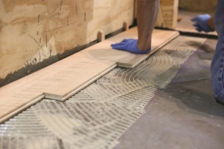 "Before wood flooring can be installed over a concrete substrate, it must be flat to within 3/16"" in 10 feet, or 1/8"" within 6 feet."