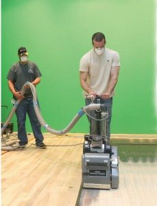 It is not necessary to fully sand the floor to restore the finish. Abrade and recoat may suffice.