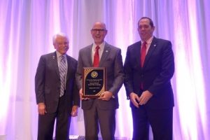 NTCA Tile Person of the Year Martin Howard of David Allen Company pictured with former NTCA Ring of Honor recipient Robert Roberson (l.), Board Chairman of David Allen Company, and NTCA Board Chairman James Woelfel (r.), who presented the award to Howard.