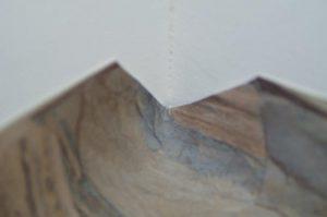 Photo #1: Cutting the inside corner to lay flat.