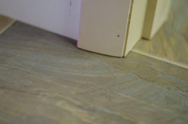 Photo #9: Cutting the doorjamb.