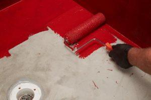 Applying waterproofing membrane to top of mortar bed