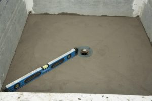 Sloping mortar bed to the drain
