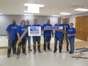 Employee volunteers who installed flooring donated by Armstrong Flooring at the Boys & Girls Club of Lancaster as part of Day of Caring. From left to right are: Rodney Johnson, Susan Stoeckl, Josh Slaven, Jason Ness, Jose Torres, Jeremy Lakeman, Chris Grow, Jenniffer Harsh