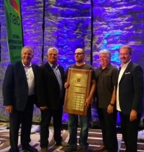 Apprentice Mike McLaughlin (center), Local 27 Ontario, was named the winner of the flooring installation competition, showcasing his expertise.