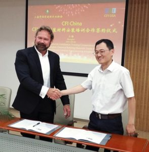 Robert Varden, CFI, and Mr.Qi (Chun Yuan Qi) of Shanghai Chemical Building Materials Trade Association, at the CFI China Signing Ceremony