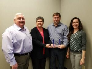 Fishman Flooring Solutions was recently named the 2017 Distributor of the Year by the Floor Covering Distributor Alliance (FCDA). Fishman President and CEO Bob Wagner (left) celebrated the recognition with Fishman team members Mary Henritz (holding the award), Shane Richmond and Stephanie Moliterno.