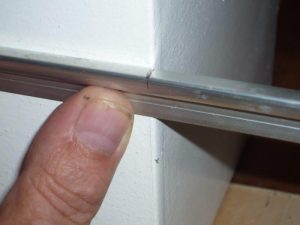 Photo 1: Marking the outside corner - you can either mark or measure the metal.