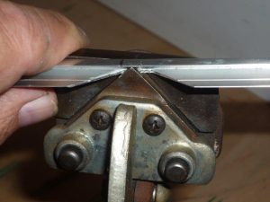 Photo 4: Cutting the miter in the metal.