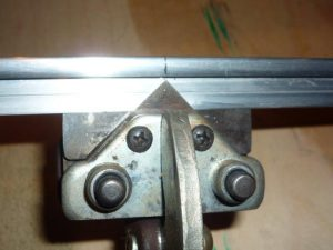Photo 8: Cutting away the metal back flange.