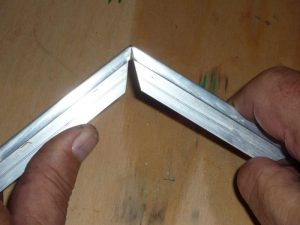 Photo 14: Bending the metal to the proper angle.