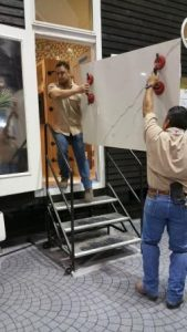Certified Tile Installers loading large format tile into Tiny House 2017 for installation