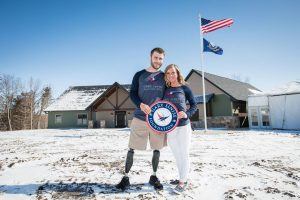 NWFA Completes 26th Home with Gary Sinise Foundation. The proud homeowners US Navy EOD2 Taylor Morris, and his wife, Danielle, are pictured here.