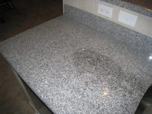 Water test on granite countertop. If you see this result, it's time to reseal.