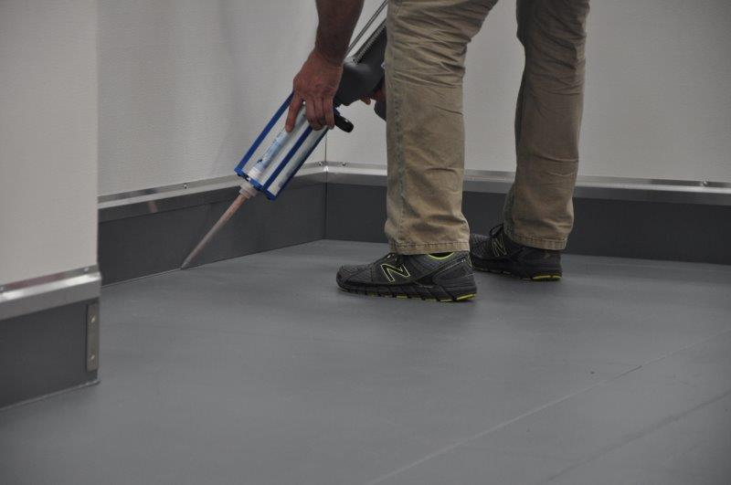 Make sure to seal between the flooring material and the cover base.