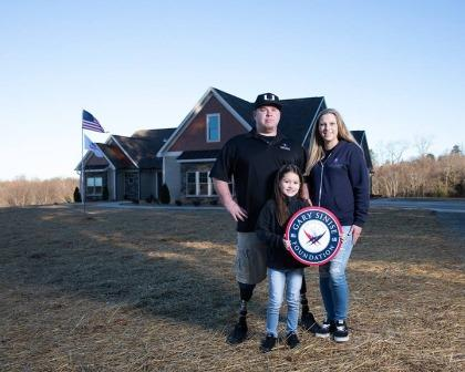 US Army SPC Tyler Jeffries, his wife Lauren, and daughter Ella.