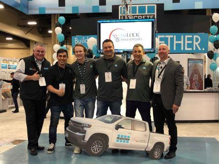 LATICRETE Reps: LATICRETE Vice President of Sales North America Ron Nash (far left) and Senior Product Manager Ryan Blair (far right) with John and Mike Imperial and their son's at SURFACES.