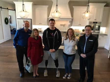 In the kitchen of the Murphys' new smart home (L to R): MAPEI Business Development Leader Dale Penland, MAPEI Marketing Communications Manager Jennifer Kramer, United States Army Captain (Ret.) Jake Murphy, Jake's wife Lisa Murphy and MAPEI Central Area Sales Director Kyle Murphy