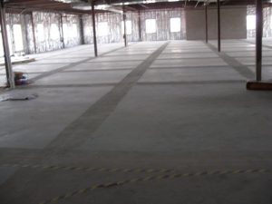 A concrete slab being readied for preparation at many of the control joints.