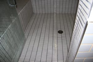 Slippery tile specified causing plumbing official to close the steam room