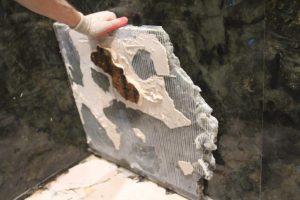 Stone slab was spot set leaving voids under the tile